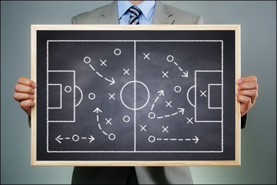 Business strategy businessman holding a blackboard planning team strategy on a chalk drawing of a so